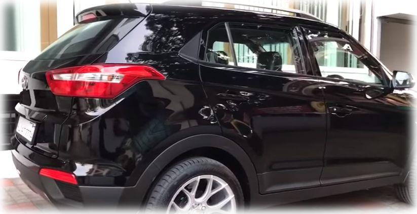 Боковое фото черного автомобиля